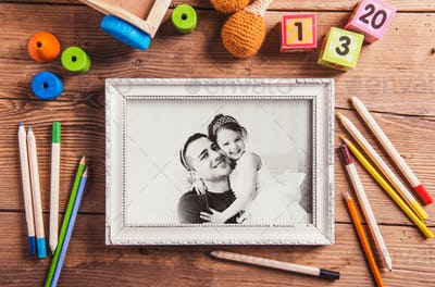 Fathers day concept. Black-and-white photo. Various toys.