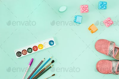 Paint and brushes . Back to school concept.