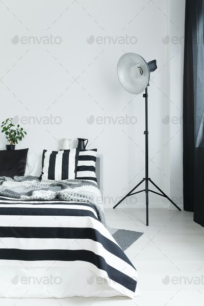 Bed with bedding and lamp
