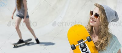 Woman in sunglasses holding skateboard