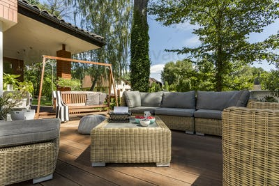 Cozy terrace with wicker furniture