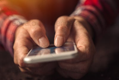 Adult female hands with mobile phone