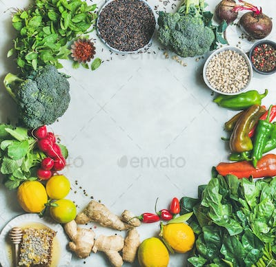 Clean eating healthy cooking ingredients over grey marble background