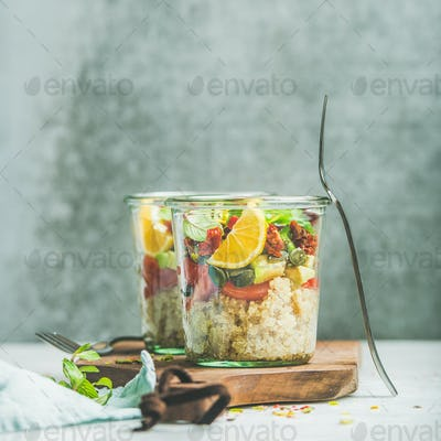 Healthy salad with quionoa, avocado, dried tomatoes, square crop
