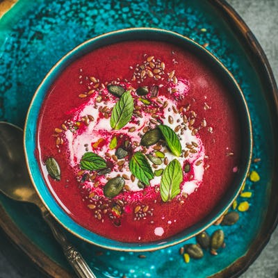 Beetroot vegetarian soup with mint, chia, flax and pumpkin seeds