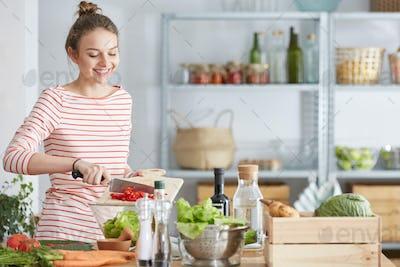 Woman preparing vegetarian meal