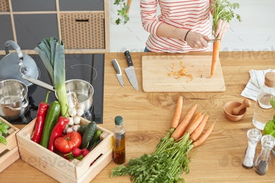 Wooden table with vegetables