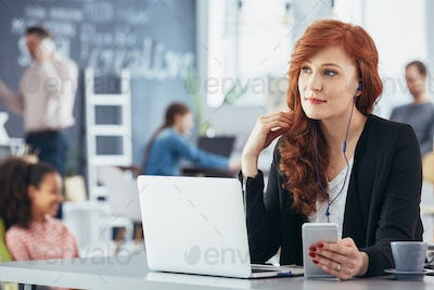 Woman listening music while working