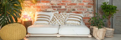 White sofa against brick wall
