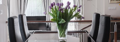 Violet tulips in dining room