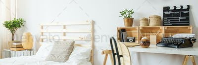 White bedroom with wooden bed