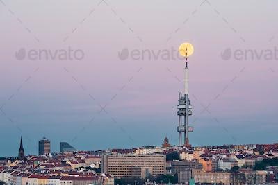 Prague skyline with full moon