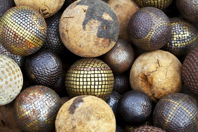 Wooden and metallic balls