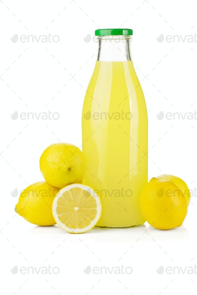 Bottle of lemon juice and fresh lemons