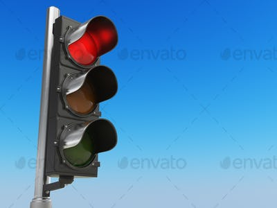 Traffic light with red color on blue sky background. Stop concep