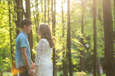 Closeup photo of romantic couple outdoors, side view.