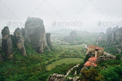 Fog landscape of Meteora Rocks , Greece