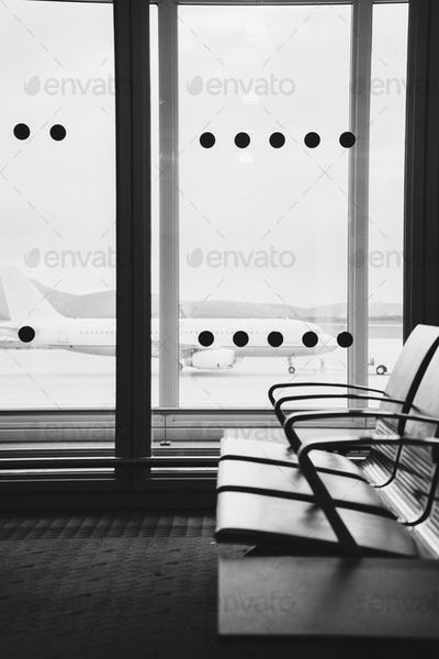 Empty airport terminal waiting area with chairs in Athens airpor