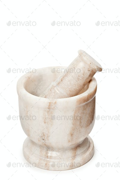 Marble mortar and pestle on white