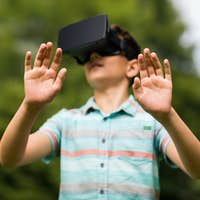 boy with virtual reality headset outdoors