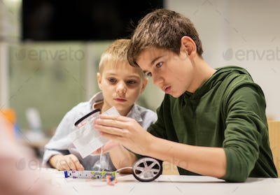 happy children building robots at robotics school
