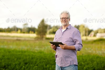 senior man with tablet pc computer at county