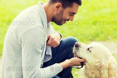 close up of man with labrador dog outdoors