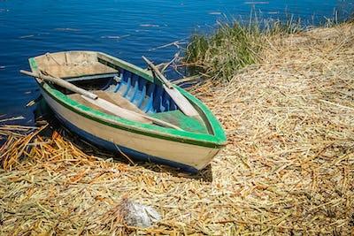 Small boat on a Titicaca lake,