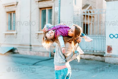 Mom and girl playing, having fun