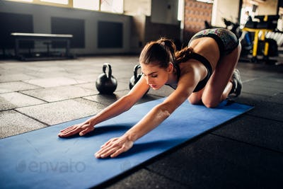 Young woman on fitness workout in sport club