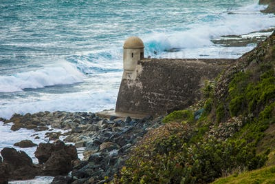 storm waves crashing against El Morro