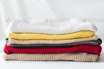 close up of stacked knitted clothes