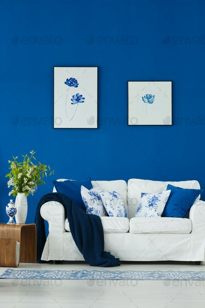 Sofa against blue wall