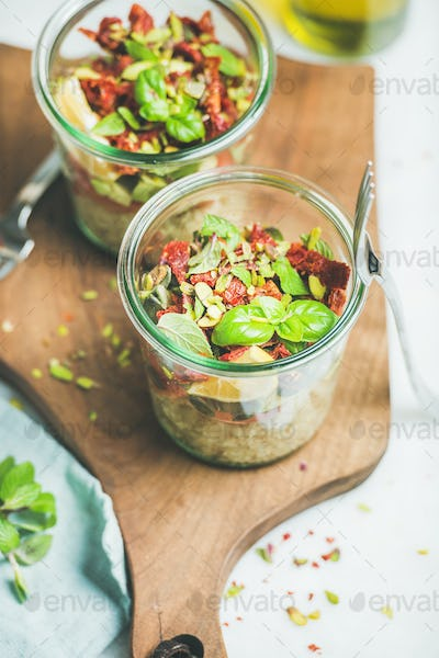Healthy vegan salad with quionoa, avocado, dried tomatoes, mint