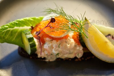 close up of toast skagen with caviar and bread