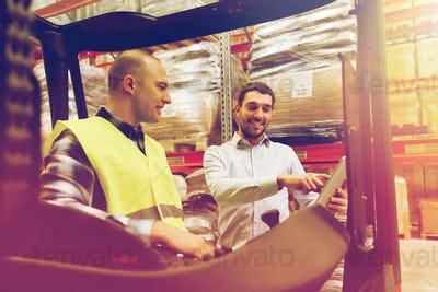 happy men with tablet pc and forklift at warehouse