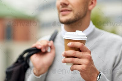 close up of man with coffee cup on street