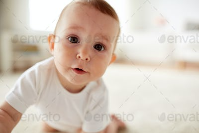 close up of happy little baby boy or girl at home