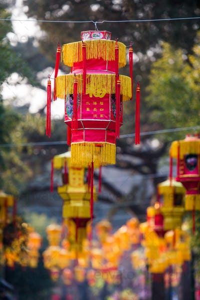 Yellow chinese lantern with messages wishing good luck, health, peace and prosperity