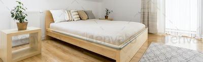 Wooden bed in bedroom