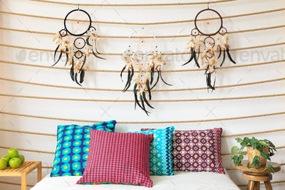 Cushions under dreamcatchers