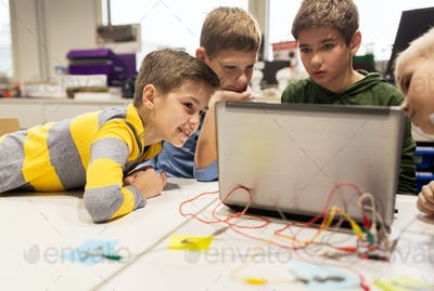 kids, laptop and invention kit at robotics school