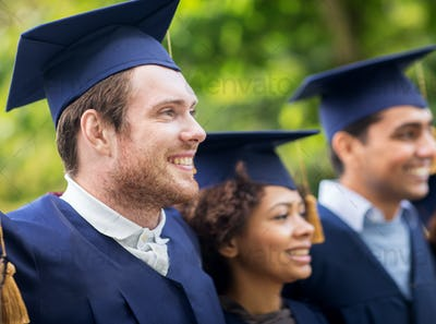 happy students or bachelors in mortar boards