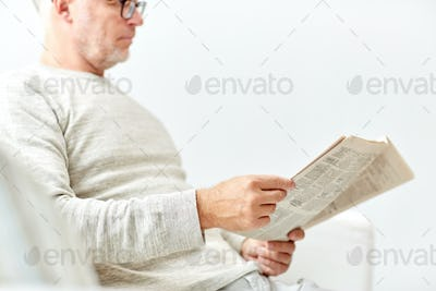 close up of senior man reading newspaper
