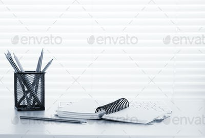 Office workplace with pc, notepad and pencils