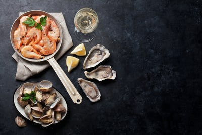 Fresh seafood and white wine. Scallops, oysters and shrimps