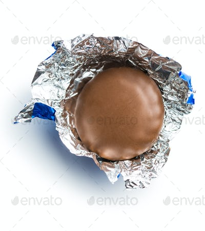 Chocolate biscuit wrapped in aluminium foil.