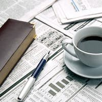 Cup of coffee on the newspaper