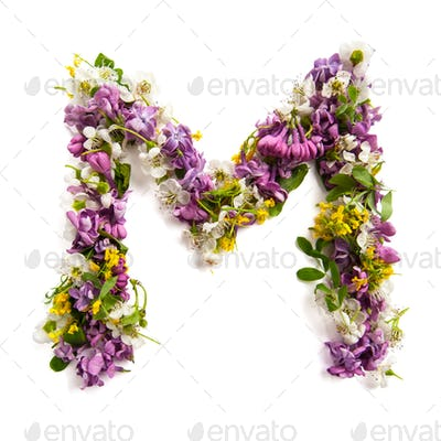 The letter «M» made of various natural small flowers.