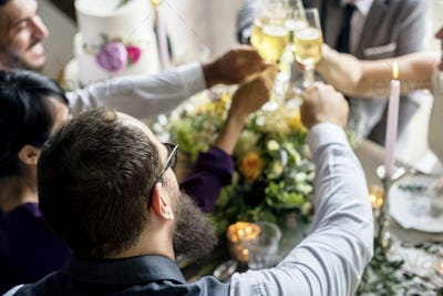Group of Diverse People Clinking Wine Glasses Together Congratul